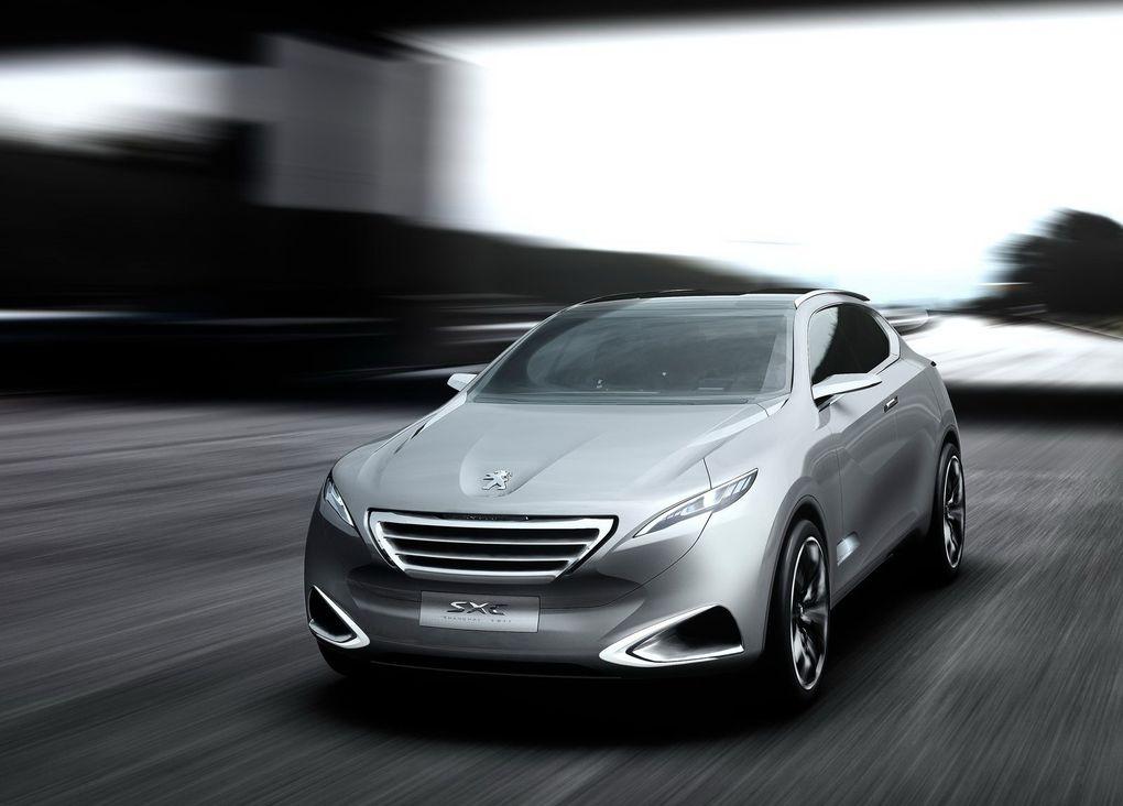Le concept-car SxC est un crossover au style très agressif, dessiné par le centre de design chinois de PSA.Il est propulsé par un moteur hybride essence de 313 ch, pour une consommation inférieure à 6 l/100 km !