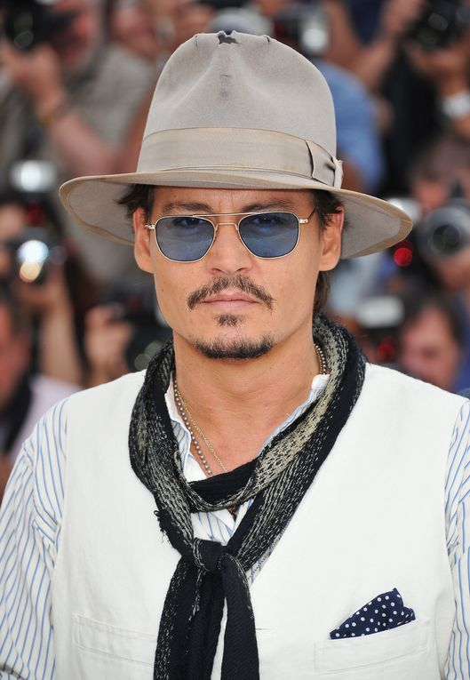 "CANNES, FRANCE - MAY 14, 2011 Actors Sam Caflin, Astrid Berges-Frisbey, Johnny Depp, and Penelope Cruz attend the ""Pirates of the Caribbean: On Stranger Tides"" photocall 