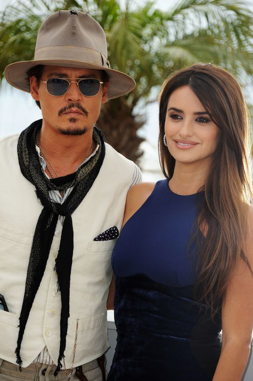 """CANNES, FRANCE - MAY 14, 2011 Actors Sam Caflin, Astrid Berges-Frisbey, Johnny Depp, and Penelope Cruz attend the """"Pirates of the Caribbean: On Stranger Tides"""" photocall at the Palais des Festivals during the 64th Cannes Film Festival on May 14, 201"""
