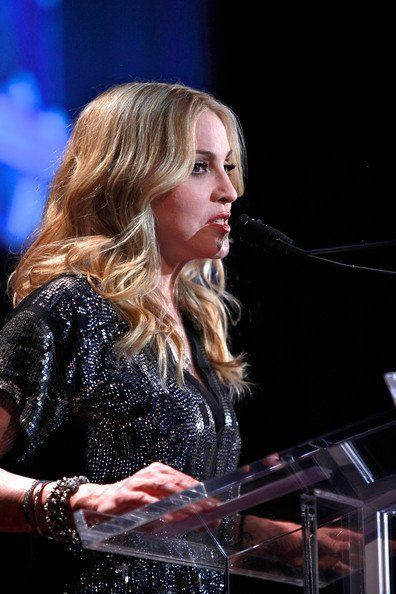 Madonna presents an award to Neil Cole of the Iconix Brand at the 5th Fashion Delivers Gala - Waldorf-Astoria Hotel, New York - November 3, 2010
