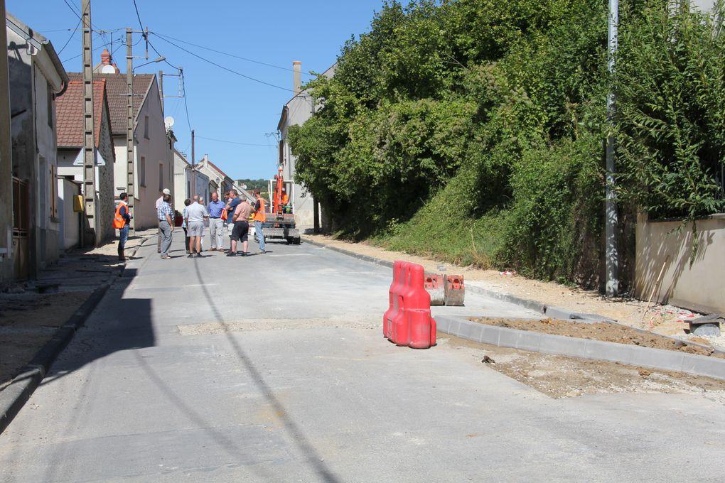 Travaux d'aménagement des trottoirs et de la voirie de la Grande Rue.