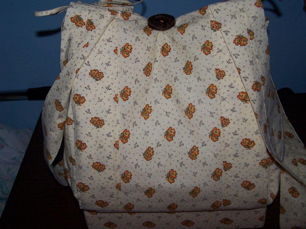 Je l'ai réalisé au mois de septemnbre 2009,toujours dans le tissu de mon costume PROVENCAL.