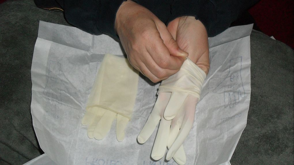 She put on tight surgical gloves 6.5