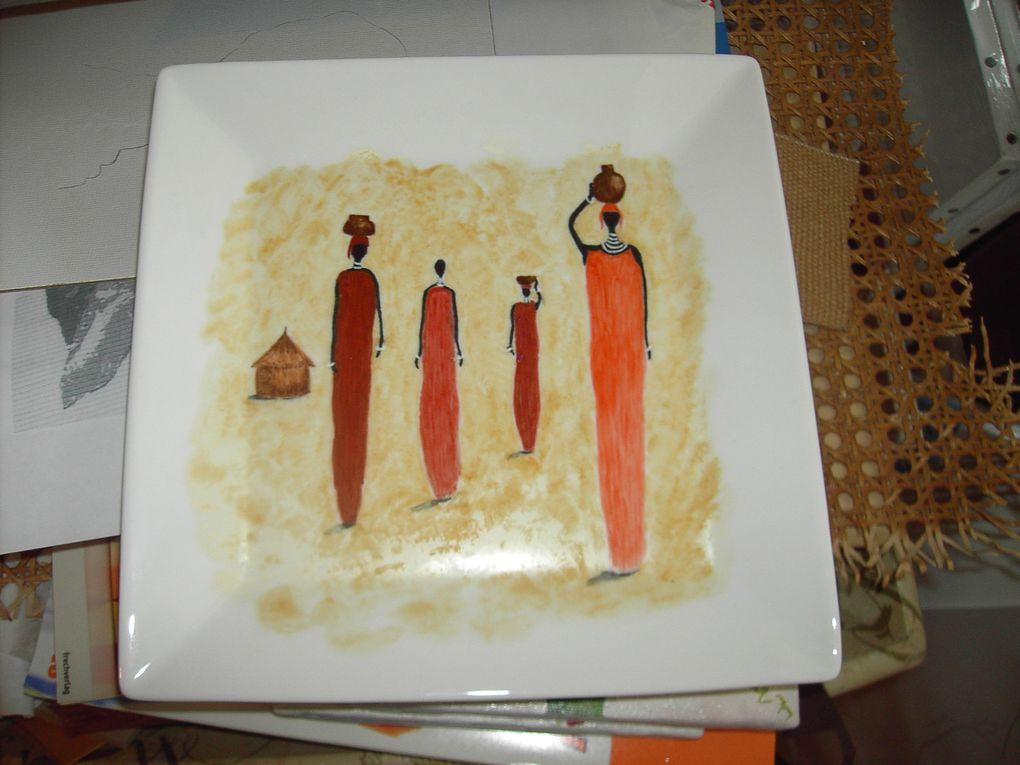 Différentes peintures sur divers supports ayant pour thème commun l'afrique