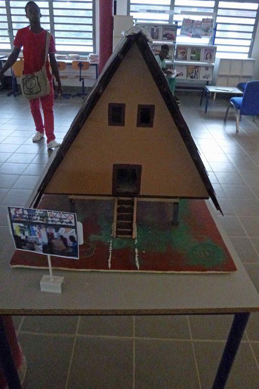 réalisations d'un projet long 3ans en partenariat avec le Service Patrimoine de la mairie de St Laurent, 4 maquettes de maisons typiques de notre ville.