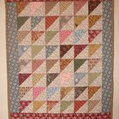 Scrappy triangles doll quilt - Tempus fugit
