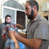 (Graphic) Muslim trophy in Syria: lifeless body of decapitated Christian child