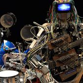 Meet the robot guitarist with 78 fingers and coolest cable hair you've ever seen