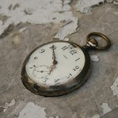 stock old broken pocket watch