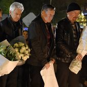 U2 pays tribute to Paris attack victims at memorial near theater