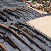 Man held over wartime firearms find