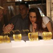 Ancient gold bracelets and coins recovered from thieves on display at Romanian museum