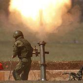 """Les """"volontaires"""" russes en Syrie, symboles d'un monde entre guillemets"""