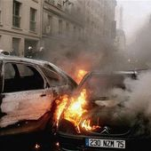 Almost 1,000 cars torched around France on New Year's Eve but government insists it 'went particularly well'