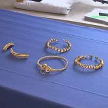 GVs of David Booth with the Iron Age hoard he found