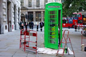 A green phone box in The City in London !