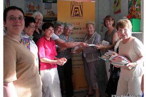 ER 23/06/11 - L'association ZONTA offre des livres à Mosaique