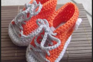 des baskets orange pour Mr Bébé
