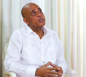 "The Economist  : "" Mr Martelly would have to step aside. As a consolation, he could be invited back to hand over power formally to his successor—and perhaps to warble a bit of compas."