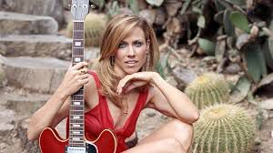 Terminons le week-end avec Sheryl Crow .