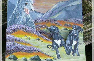 Deerhound et chiots peints dans un paysage écossais