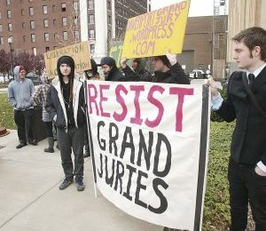 PROTESTORS, HEAVY POLICE PRESENCE MARK GRAND JURY PROCEEDINGS