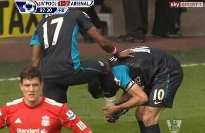 Van Persie celebrates by kissing Song's boot