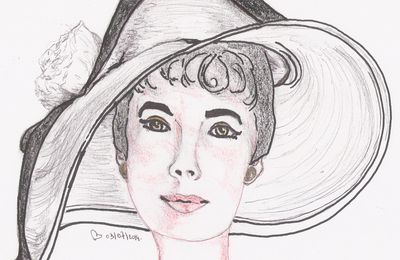belle avec son chapeau :