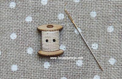 Botones en forma de bobina de hilo