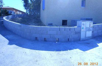 Mur de clôture virage