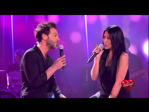Anggun and Christophe Maé performing Charly during the show Televie