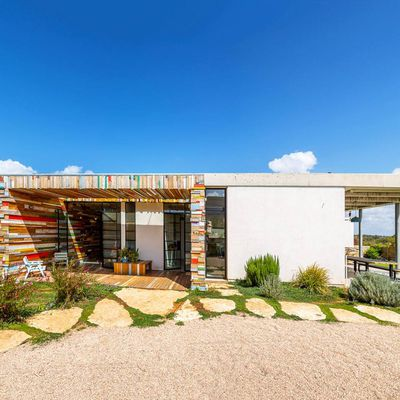 Israel's striking LAHO House is wrapped with colorful reclaimed wood
