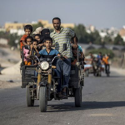 Palestinian residents of Umm al-Nasser ride back to their homes
