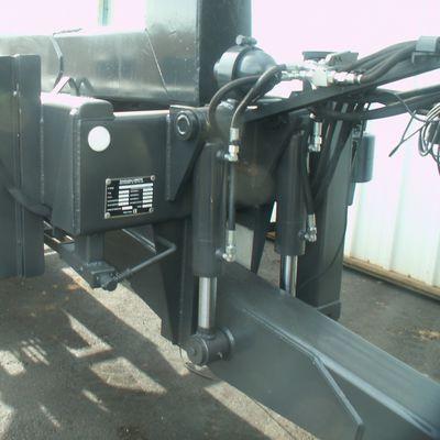 Flèche à suspension hydraulique