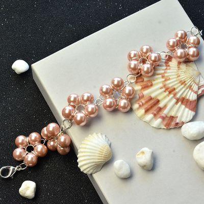 Pulsera rosa flor de perlas con anillos de salto