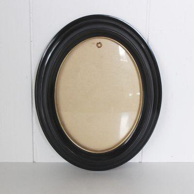 Petit cadre oval noir et doré Années 60 - Vintage