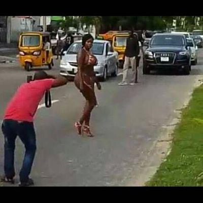 What this lady wears to take pictures on busy Lagos road will get you shocked.