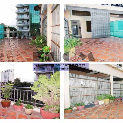 USD 400 / month ( BKK1 : Big terrace  Khmer House / Flat 2 bedrooms / 2 bathrooms  for rent )