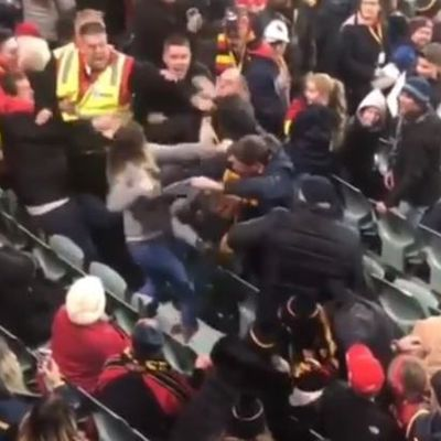 Adelaide Oval crowd incident as woman filmed slapping, punching man