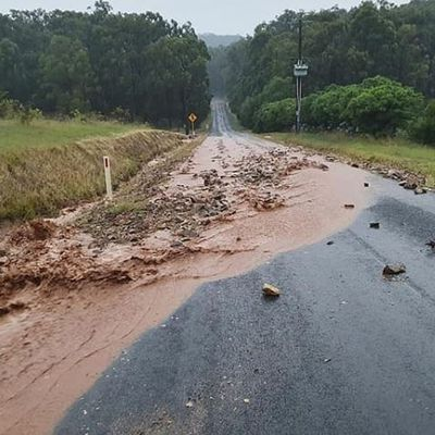 Rain and hail pelt fire-ravaged Australian states, bringing new risks -- and potential relief